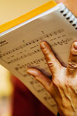vertical stock photography | Music, Musician holding score, image id 5-820-3760