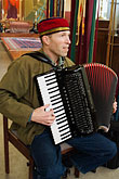 church stock photography | California, San Francisco, Church musician playing the accordian, image id 6-410-4277
