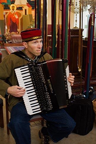 image 6-410-4295 California, San Francisco, Church musician playing the accordian