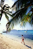 woman walking stock photography | St. Vincent, Tobago Cays, Horseshoe Reef, Petit Bateau island, image id 3-610-65