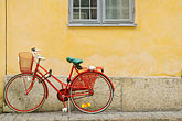 red stock photography | Sweden, G�teborg, Bicycle leaning against wall, image id 5-700-2032