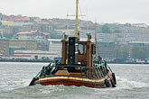 horizontal stock photography | Sweden, G�teborg, G�teborg Harbor, Tugboat, image id 5-700-4881
