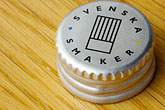 aquavit bottlecap stock photography | Sweden, G�teborg, Aquavit bottlecap, image id 5-700-5171