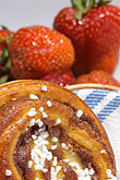 fattening foods stock photography | Food, Cinnamon bun and strawberries, image id 5-710-2338