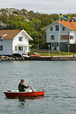 row of houses stock photography | Sweden, Marstrand, Rowing in the harbor, image id 5-710-5426