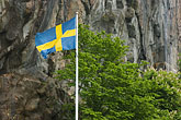 national flag stock photography | Sweden, Fjallbacka, Swedish flag and cliffside, image id 5-710-5505