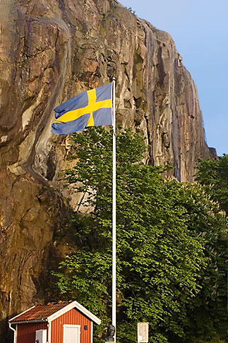 image 5-710-5515 Sweden, Fjallbacka, Swedish flag and cliff