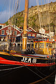 multicolour stock photography | Sweden, Fjallbacka, Fishing boat in harbor, image id 5-710-5520