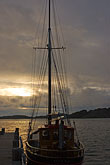 twilight stock photography | Sweden, Fjallbacka, Fishing boat in harbor, image id 5-710-5529