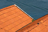 tiled roof stock photography | Sweden, West Sweden, Red rooftops, image id 5-710-5784