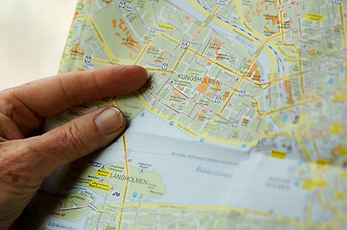 5-720-2652  stock photo of Sweden, Stockholm, Looking at the map