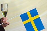 sparkling wine stock photography | Sweden, Swedish flag and champagne glass, image id 5-720-2753