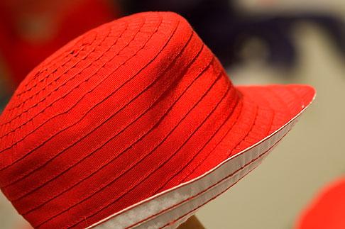 image 5-720-3963 Sweden, Stockholm, Red hat in shop
