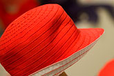 apparel stock photography | Sweden, Stockholm, Red hat in shop, image id 5-720-3963