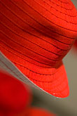 close up stock photography | Sweden, Stockholm, Red hat in shop, image id 5-720-3967