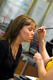 sell stock photography | Sweden, Stockholm, Woman getting Beauty Makeup , image id 5-720-3982