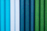 parallel stock photography | Still life, Blue and green Cloth bound notebooks, image id 5-720-4053