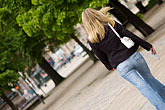 woman walking stock photography | Sweden, Stockholm, Crossing the street, image id 5-720-4118