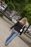 woman walking stock photography | Sweden, Stockholm, Woman in park, image id 5-720-4120