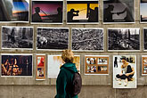women looking at art display stock photography | Sweden, Stockholm, Photos on wall at street fair, image id 5-720-4172