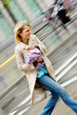 woman walking stock photography | Sweden, Stockholm, Crossing the street, image id 5-720-7098