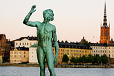 gamla stan stock photography | Sweden, Stockholm, Song statue, Stadshuset, bronze by Carl Eldh, image id 5-720-7850