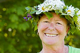 happy stock photography | Sweden, Grinda Island, Woman wih flower wreath for midsummer, image id 5-730-3409