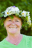happy stock photography | Sweden, Grinda Island, Woman wih flower wreath for midsummer, image id 5-730-3415