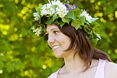 happy stock photography | Sweden, Grinda Island, Woman wih flower wreath for midsummer, image id 5-730-3429