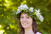 happy stock photography | Sweden, Grinda Island, Woman wih flower wreath for midsummer, image id 5-730-3444