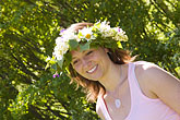 happy stock photography | Sweden, Grinda Island, Woman wih flower wreath for midsummer, image id 5-730-3450