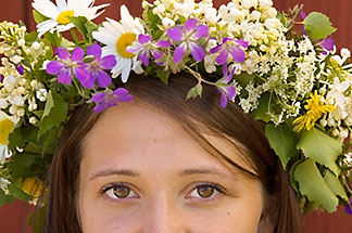 5-730-3551  stock photo of Sweden, Grinda Island, Woman wih flower wreath for midsummer