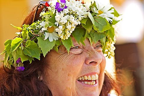 image 5-730-3628 Sweden, Grinda Island, Woman wih flower wreath for midsummer