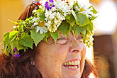 happy stock photography | Sweden, Grinda Island, Woman wih flower wreath for midsummer, image id 5-730-3628