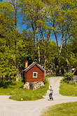 woman walking stock photography | Sweden, Grinda Island, Red house, image id 5-730-6438