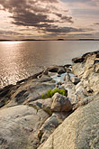 twilight stock photography | Sweden, Grinda Island, Rocky shoreline, image id 5-730-6459