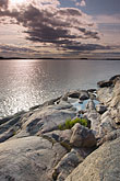 twilight stock photography | Sweden, Grinda Island, Rocky shoreline, image id 5-730-6460