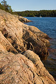 lakeside stock photography | Sweden, Grinda Island, Rocky shoreline, image id 5-730-6473