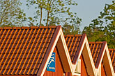 red tile stock photography | Sweden, Grinda Island, Red boathouse, image id 5-730-6544