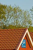 tiled roof stock photography | Sweden, Grinda Island, Red boathouse, image id 5-730-6546