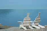 lakeside stock photography | Sweden, Grinda Island, Adirondack chairs, image id 5-730-6584