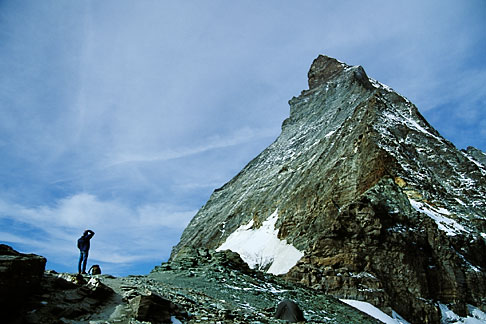 image 2-104-25 Switzerland, Alps, Hiker looking at the East face of the Matterhorn