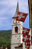 church tower stock photography | Switzerland, Chur, Flags of Graub�nden and Kirche St Martin, image id 2-109-5