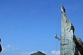 blue sky stock photography | Switzerland, Bergell, Mark McCall rappelling on La Fiamma, image id 2-98-7