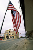 town square stock photography | Texas, Goliad, Flag, Courthouse Square, image id 1-721-33