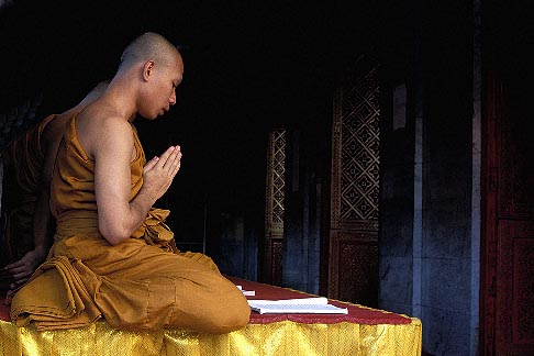 0-381-77  stock photo of Thailand, Chiang Mai, Monks praying, Wat Phra That Doi Suthep