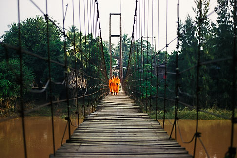 image 0-383-10 Thailand, Sukhothai, Monks on bridge, Si Satchanalai town