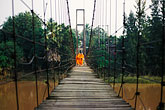pedestrian stock photography | Thailand, Sukhothai, Monks on bridge, Si Satchanalai town, image id 0-383-10