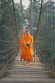 saffron stock photography | Thailand, Sukhothai, Monks on bridge, Si Satchanalai town, image id 0-383-11