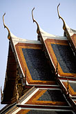 buddhist temple detail stock photography | Thailand, Bangkok, Roof of Royal Pantheon, Wat Pra Keo, image id 4-194-31